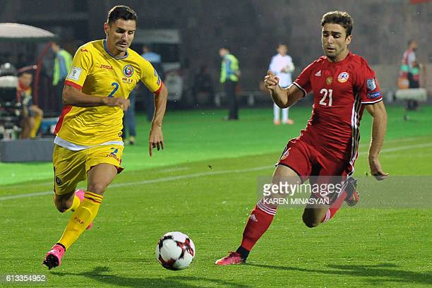 Romania's Romario Benzar vies with Armenia's Davit Manoyan during the WC 2018 football qualification match between Armenia and Romania in Yerevan on...