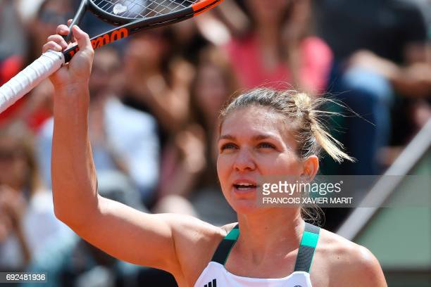Romania's Simona Halep celebrates after winning against Spain's Carla Suarez Navarro during their tennis match at the Roland Garros 2017 French Open...