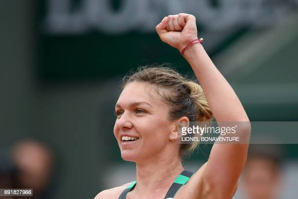 Romania's Simona Halep celebrates after winning her tennis match against Russia's Darya Kasatkina during their tennis match at the Roland Garros 2017...