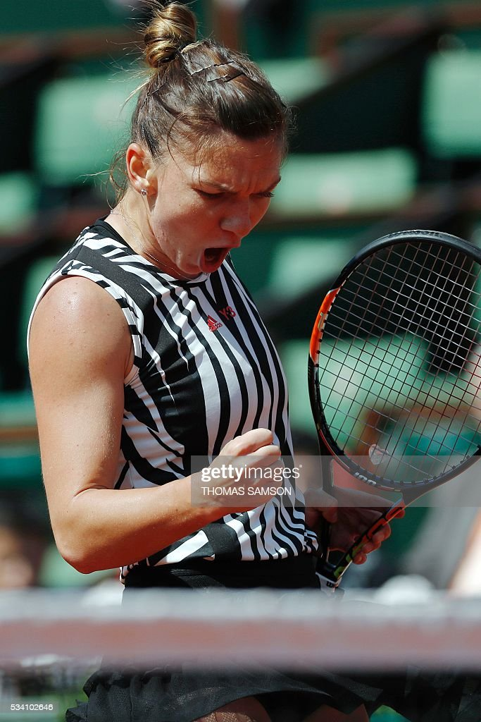 Romania's Simona Halep reacts during her women's second round match against Kazakhstan's Zarina Diyas at the Roland Garros 2016 French Tennis Open in Paris on May 25, 2016. / AFP / Thomas SAMSON