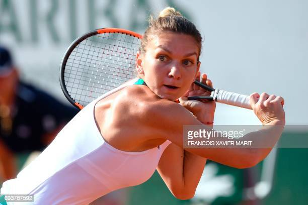 Romania's Simona Halep returns the ball to Czech Republic's Karolina Pliskova during their semifinal tennis match at the Roland Garros 2017 French...