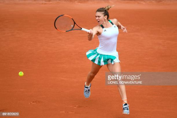 TOPSHOT Romania's Simona Halep returns the ball to Russia's Darya Kasatkina during their tennis match at the Roland Garros 2017 French Open on June 3...