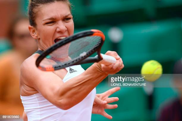 Romania's Simona Halep returns the ball to Russia's Darya Kasatkina during their tennis match at the Roland Garros 2017 French Open on June 3 2017 in...