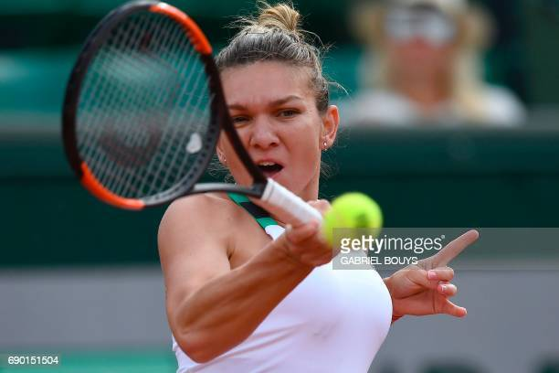Romania's Simona Halep returns the ball to Slovakia's Jana Cepelova during their tennis match at the Roland Garros 2017 French Open on May 30 2017 in...