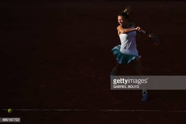 TOPSHOT Romania's Simona Halep returns the ball to Slovakia's Jana Cepelova during their tennis match at the Roland Garros 2017 French Open on May 30...