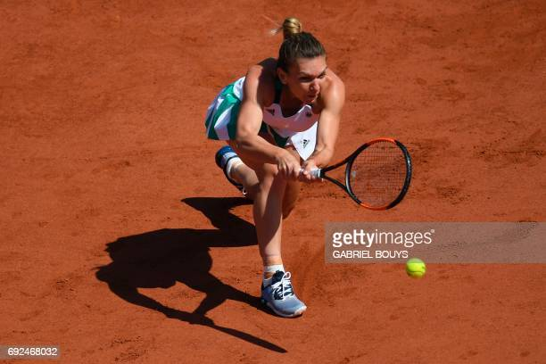 Romania's Simona Halep returns the ball to Spain's Carla Suarez Navarro during their tennis match at the Roland Garros 2017 French Open on June 5...