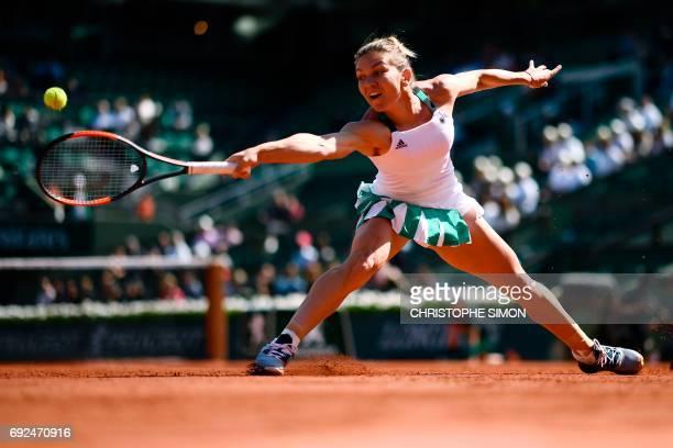 TOPSHOT Romania's Simona Halep returns the ball to Spain's Carla Suarez Navarro during their tennis match at the Roland Garros 2017 French Open on...