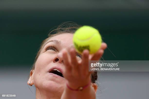 Romania's Simona Halep serves the ball to Russia's Darya Kasatkina during their tennis match at the Roland Garros 2017 French Open on June 3 2017 in...
