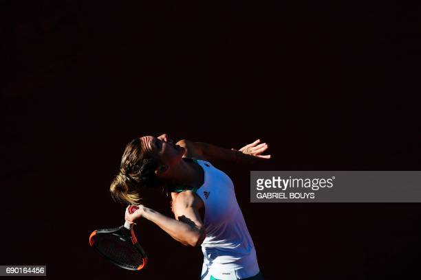 Romania's Simona Halep serves to Slovakia's Jana Cepelova during their tennis match at the Roland Garros 2017 French Open on May 30 2017 in Paris /...