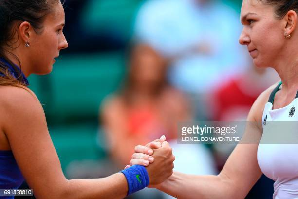Romania's Simona Halep shakes hands with Russia's Darya Kasatkina after winning their tennis match at the Roland Garros 2017 French Open on June 3...