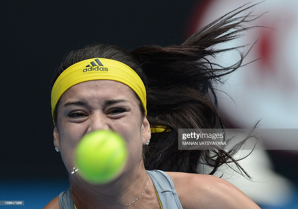 Romania's Sorana Cirstea hits a return against China's Li Na during their women's singles match on day five of the Australian Open tennis tournament in Melbourne on January 18, 2013.