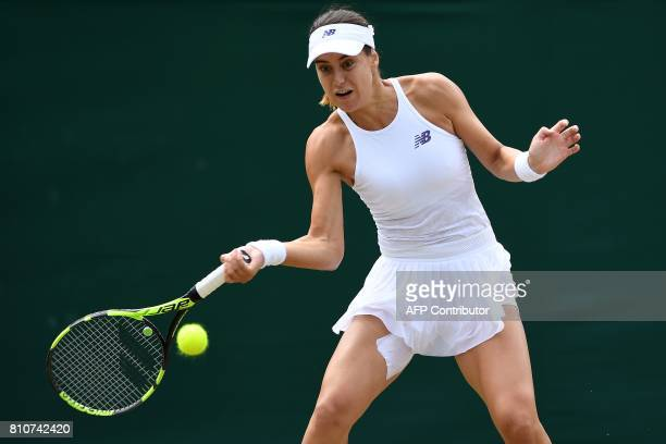 Romania's Sorana Cirstea returns against Spain's Garbine Muguruza during their women's singles third round match on the sixth day of the 2017...