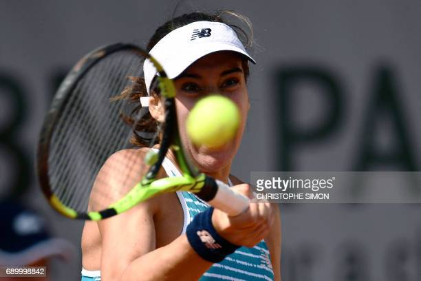 Romania's Sorana Cirstea returns the ball to China's Shuai Peng during their tennis match at the Roland Garros 2017 French Open on May 30 2017 in...