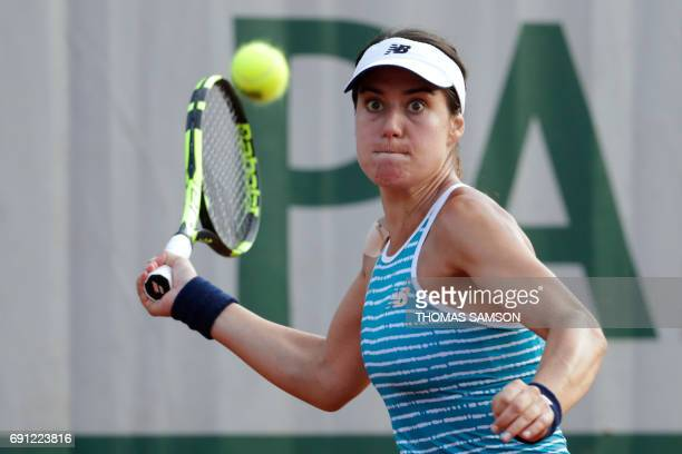 Romania's Sorana Cirstea returns the ball to Spain's Carla Suarez Navarro during their tennis match at the Roland Garros 2017 French Open on June 1...