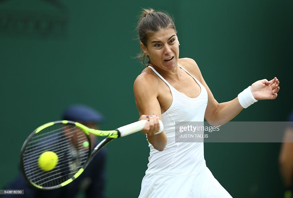 Romania's Sorana Cirstea returns to Czech Republic's Petra Kvitova during their women's singles first round match on the third day of the 2016 Wimbledon Championships at The All England Lawn Tennis Club in Wimbledon, southwest London, on June 29, 2016. / AFP / JUSTIN
