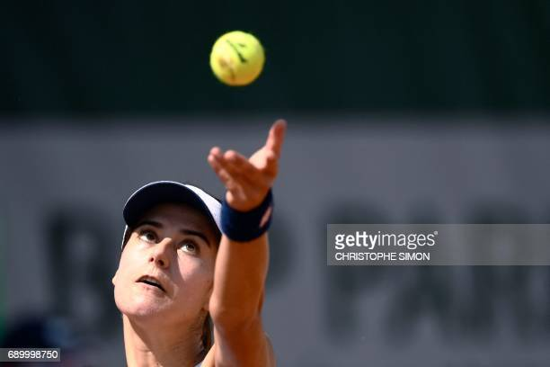 Romania's Sorana Cirstea serves the ball to China's Shuai Peng during their tennis match at the Roland Garros 2017 French Open on May 30 2017 in...