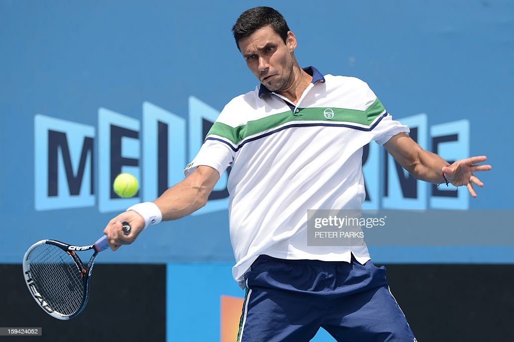 Romania's Victor Hanescu plays a return to Japan's Kei Nishikori during their men's singles match on the first day of the Australian Open tennis tournament in Melbourne on January 14, 2013.