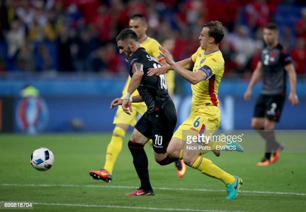 Romania's Vlad Chiriches and Albania's Armando Sadiku battle for the ball