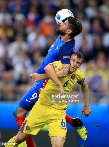 Romania's Vlad Chiriches and France's Olivier Giroud battle for the ball