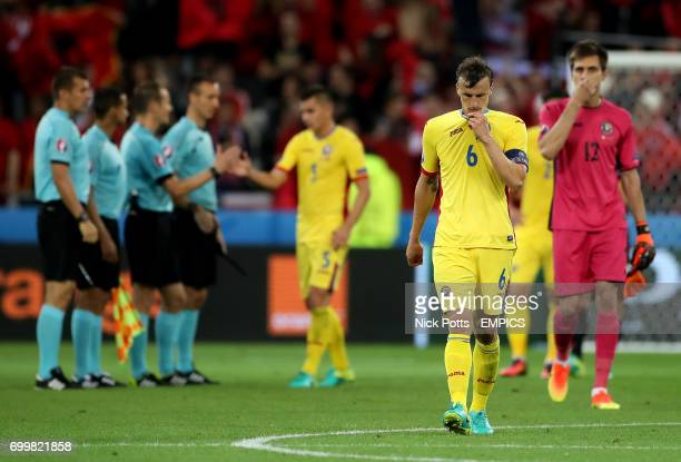 Romania's Vlad Chiriches appears dejected after the final whistle