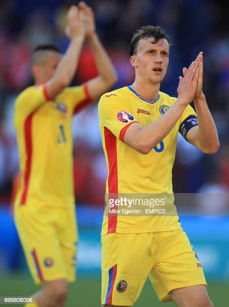 Romania's Vlad Chiriches applauds supporters after the final whistle