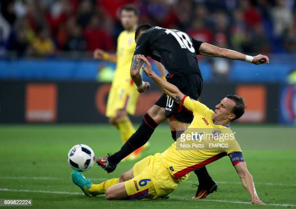 Romania's Vlad Chiriches slides in on Albania's Armando Sadiku