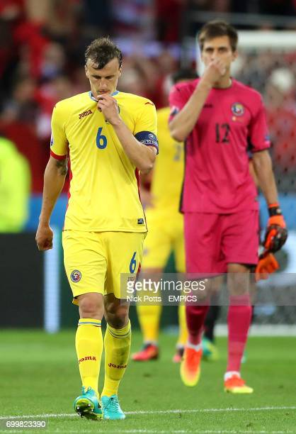 Romania's Vlad Chiriches walks off the pitch dejected after the game