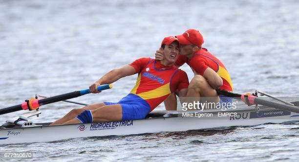 Romania's VladDragos Aicoboae and ToaderAndrei Gontaru celebrate first place in the Junior Men's Pairs Final