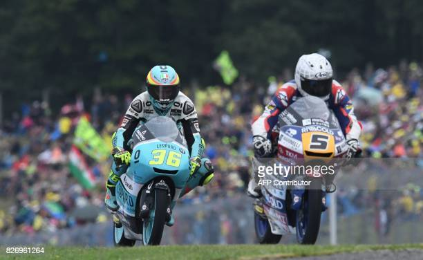 Romano Fenati of Italy and Joan Mir of Spain compete during the Moto3 event of the Grand Prix of the Czech Republic in Brno on August 6 2017 / AFP...