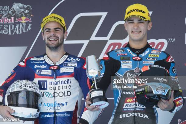 Romano Fenati of Italy and Marinelli Rivacold Snipers Team and Aron Canet of Spain and Estrella Galicia 00 celebrate on the podium at the end of the...