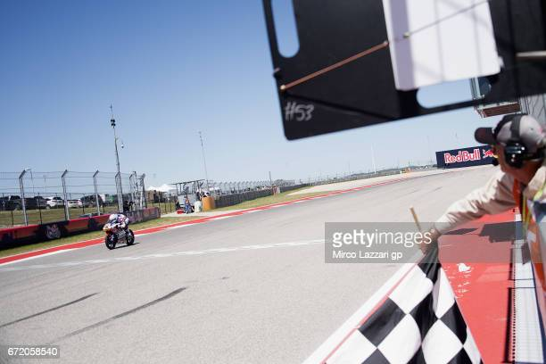 Romano Fenati of Italy and Marinelli Rivacold Snipers Team cuts the finish lane and celebrates the victory at the end of the Moto3 race during the...