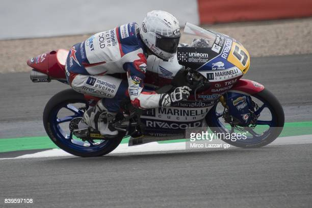 Romano Fenati of Italy and Marinelli Rivacold Snipers Team heads down a straight during the MotoGp Of Great Britain Qualifying at Silverstone Circuit...