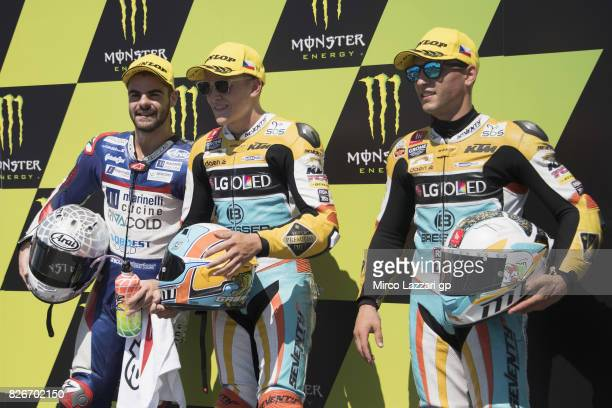 Romano Fenati of Italy and Marinelli Rivacold Snipers Team Juanfran Guevara of Spain and RBA BOE Racing Team and Gabriel Rodrigo of Argentina and RBA...