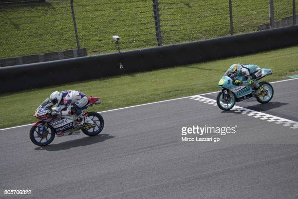 Romano Fenati of Italy and Marinelli Rivacold Snipers Team leads Joan Mir of Spain and Leopard Racing during the Moto3 race during the MotoGp of...