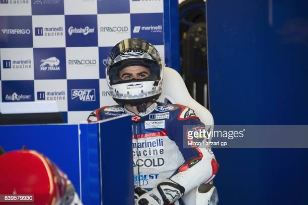 Romano Fenati of Italy and Marinelli Rivacold Snipers Team looks on in box with mechanic during the MotoGp Of Great Britain Qualifying at Silverstone...