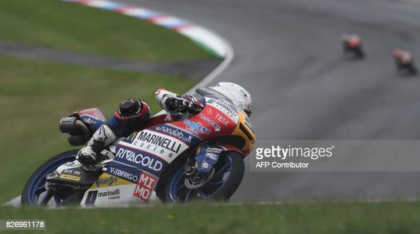 Romano Fenati of Italy rides his Honda during the Moto3 event of the Grand Prix of the Czech Republic in Brno on August 6 2017 / AFP PHOTO / Michal...