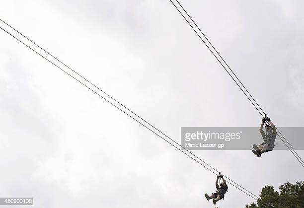 Romano Fenati of Sky Racing Team by VR46 and Danny Kent of Britain and Red Bull Husquarna Ajo hanging on the rope during the preevent 'Riders enjoy...