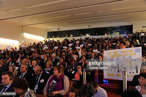 Romans unfurl banner during European Roma Summit during European Roma Summit in BrusselsBelgium on April 42014European Roma Summit is held for...