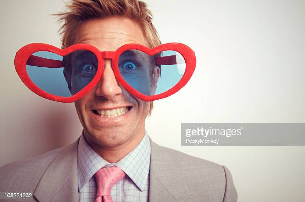 Romantic Businessman Wearing Large Heart-Shaped Glasses