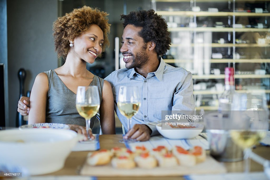 Romantic couple at a dinner party