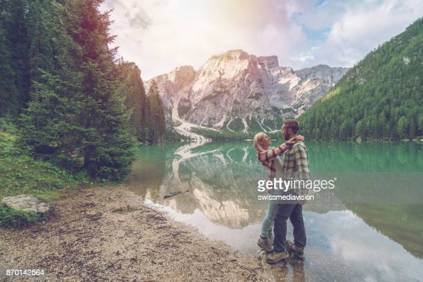 Romantic couple by the lake, mountain landscape, Dolomites, Italy