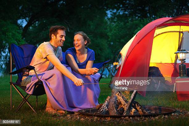 Romantic Couple Camper Roasting Marchmallows in Campground Horizontal
