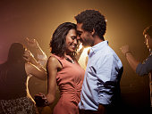 Romantic couple dancing at nightclub