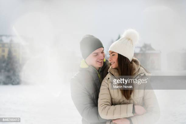 Romantic couple embracing on snowy winter day