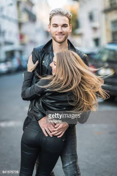 Romantic couple embracing on the European street