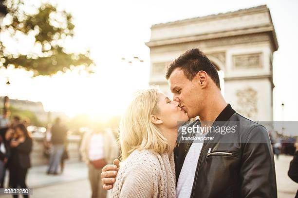 romantic couple enjoying the sunset on Paris