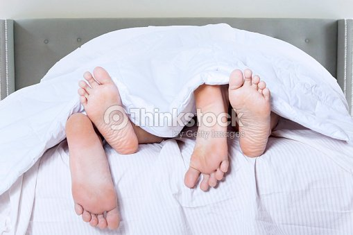 Romantic couple feet sleep in bedroom   Stock Photo. Romantic Couple Feet Sleep In Bedroom Stock Photo   Thinkstock