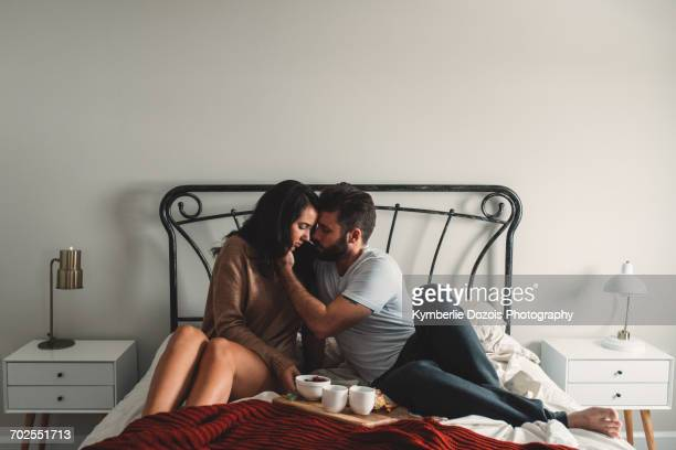 Romantic couple having breakfast in bed together