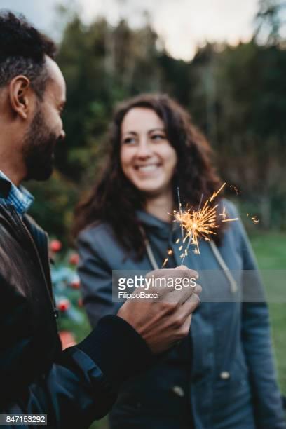 Romantic couple holding a sparkler firework