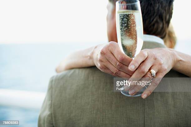 Romantic Couple Hugging and Drinking Champagne